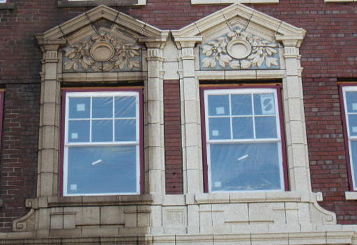 This before-and-after photo shows restoration cleaning under way on a 1928 apartment building in Gary, Ind.