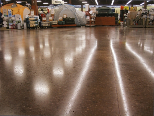 A polished concrete floor protected with Consolideck PolishGuard gleams under the lights at a Gander Mountain hunting, fishing and camping store in Florida.