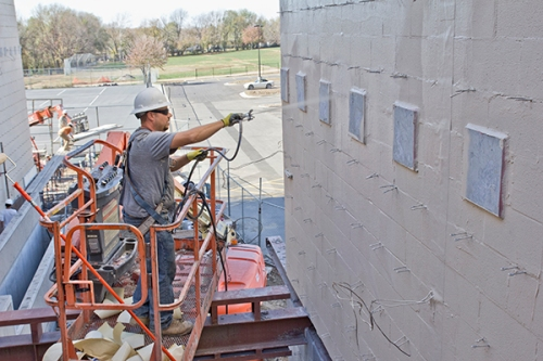 Sean Peden, Restoration & Waterproofing Contractors, Kansas City, applies primary air & water barrier PROSOCO R-GUARD MVP at Trail Ridge Middles School. Stephen Falls photo