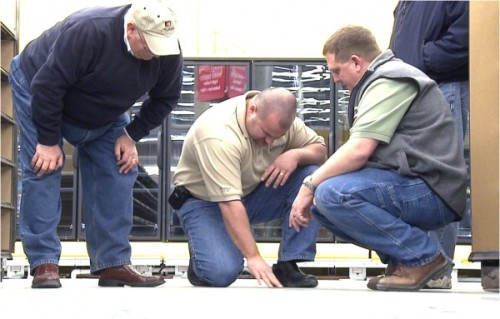 We're proud of PROSOCO's industry-best field-support. Here, Joe Reardon (center), Concrete Products Group, consults about a finished concrete floor going into a big box store.
