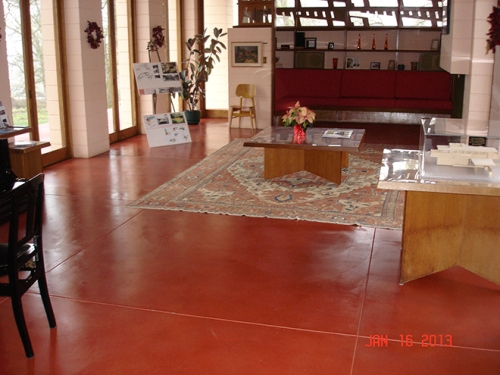 "Frank Lloyd Wright's signature ""Cherokee Red"" finished concrete floor lives again in Oregon's Gordon House, colored with Consolideck ColorHard one-step colorant and hardener/densifier. photo by Gene Bollinger"
