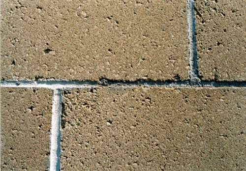 Above all, cleaners should not damage the masonry. Here, a cleaner not made for concrete masonry etched the joints and the block surface.