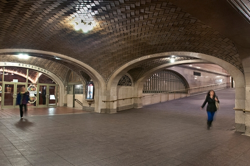"""Passengers hurry for trains in the tunnels below the terminal in this photo titled """"Whispering."""""""