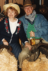Keith and Janice, spouse of 48 years, have some fun posing as cowpokes during a party for Keith's 30th anniversary at PROSOCO.