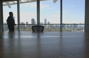 David W. Boyer, PROSOCO, views the Seattle Skyline from a top-floor conference room in the Bullitt Center during opening ceremonies for the building April 22. John Young photo