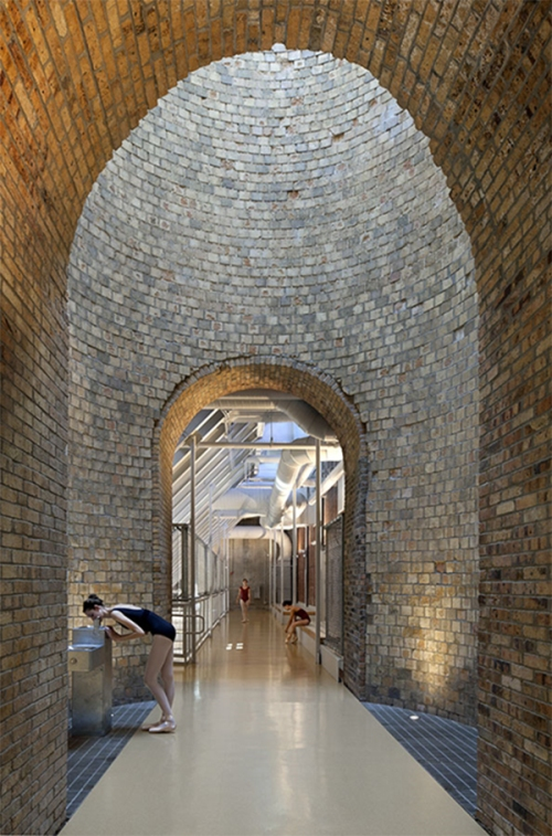 BNIM's design transformed the former powerhouse chimney into a skylight on the catwalk along the building's second level.