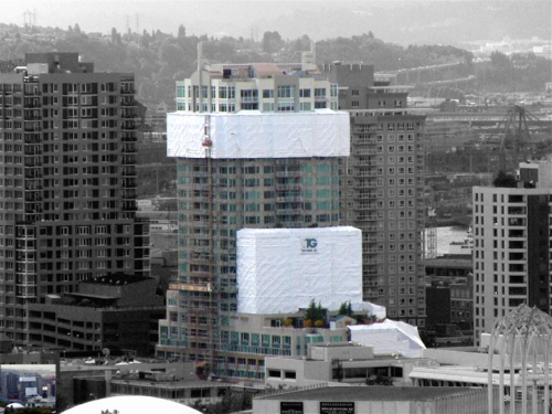 Only 3 years old, this Seattle apartment complex had its cladding removed, windows replaced, repairs made to rough openings and sheathing, and cladding replaced at a cost of $14 million, after its traditional air and water barrier products failed. This type of failure was the genesis of STPE air and water barrier products, since the contractor didn't want to make repairs with the same techniques that failed in the first place. Tatley-Grund photo.