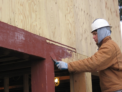 – An applicator demonstrates the relative simplicity of waterproofing a rough opening with the STPE-based flashing system. Photo courtesy BEI, LLC