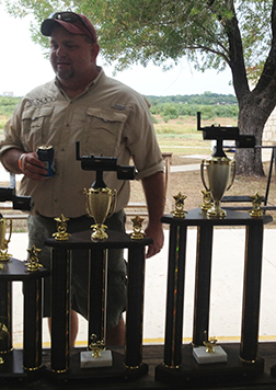 Dave Pennington, head of PROSOCO's Building Envelope Group, ponders the trophies he won Sept. 5 at a competition hosted by the San Antonio Masonry Association.