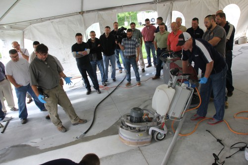 Bruce Ferrell and Patrick Sullivan, technical specialists for PROSOCO's concrete flooring products, conduct a grinding demonstration for sales managers on June 2 at PROSOCO headquarters in Lawrence, Kan.